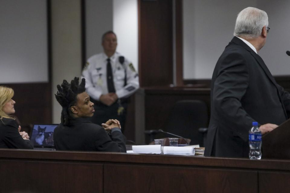 Ronnie Oneal III makes a comments while Assistant State Attorney Ronald Gale speaks during closing arguments against Oneal at the George E. Edgecomb Courthouse in Tampa, Fla., on Monday, June 21, 2021. (Ivy Ceballo/Tampa Bay Times via AP)