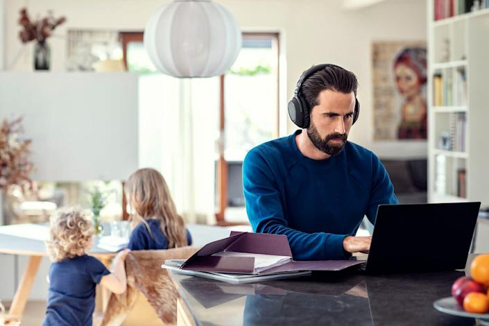 Man working from home - listening to headphones (Photo: EPOS)