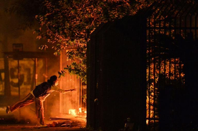 Demonstrators start a fire at the entrance to the Carrefour supermarket where a black man was beaten to death by security guards on Brazil's Black Consciousness Day, in Porto Alegre, Rio Grande do Sul, Brazil, on November 20, 2020