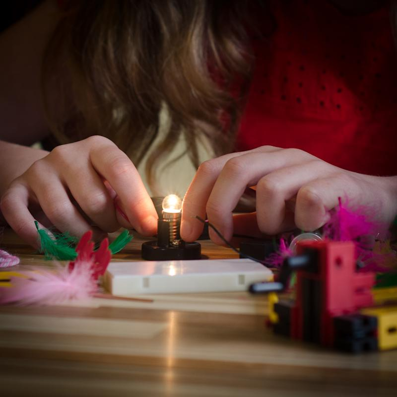 Girl playing win an electronics set