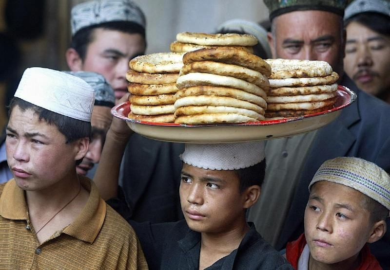 China's Xinjiang province is the homeland of the Muslim Uighur ethnic minority, many of whom complain of discrimination andcontrols on their culture and religion (AFP Photo/Frederic J. Brown)