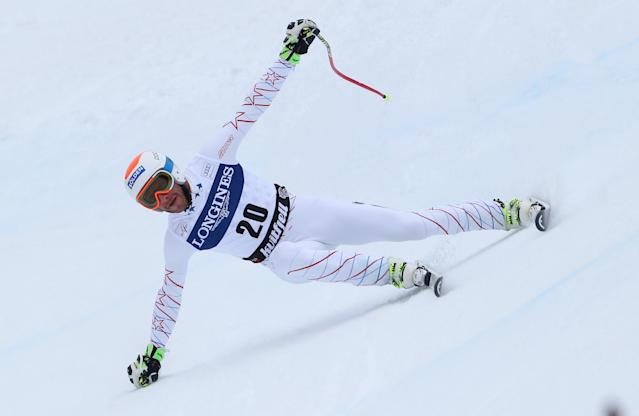 Bode Miller, of the United States, speeds down the course on his way to take the third place at an alpine ski, men's World Cup downhill, in Kvitfjell, Norway, Saturday, March 1, 2014. (AP Photo/Alessandro Trovati)