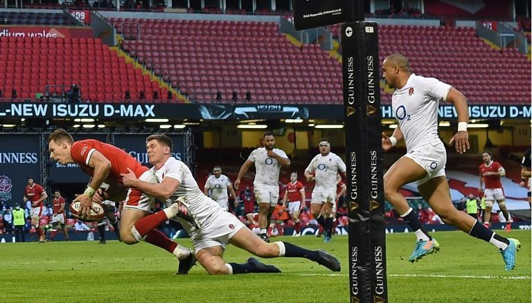 Wales full-back Liam Williams dives over to score his team's second try against England in the Six Nations