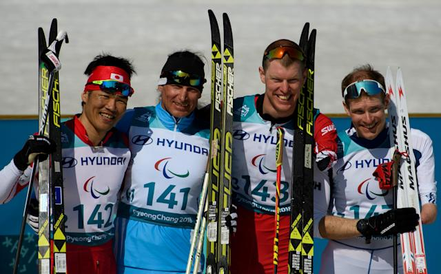 Silver Medalist Yoshihiro Nitta JPN, Gold Medalist Alexandr Kolyadin KAZ, Bronze Medalists Mark Arendz CAN and Ilkka Tuomisto FIN pose for a photograph after the Cross-Country Skiing Standing Men's 1.5km Sprint Classic Final at the Alpensia Biathlon Centre. The Paralympic Winter Games, PyeongChang, South Korea, Wednesday 14th March 2018. OIS/IOC/Thomas Lovelock/Handout via REUTERS