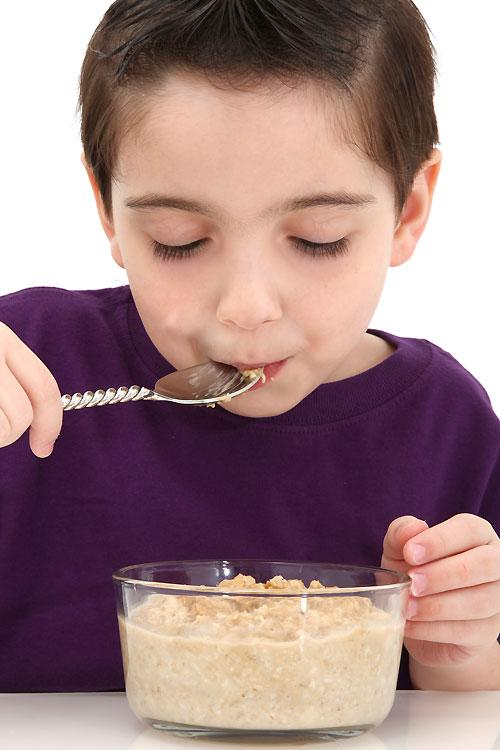 "<strong>Oatmeal</strong><br><br>Another breakfast superfood, slow-digesting, high-fibre oatmeal provides kids with ""a <a target=""_blank"" href=""http://www.parenting.com/gallery/toddler-superfoods?pnid=443335"">steady stream of energy</a>"" and can help then concentrate better at school.<br><br><a target=""_blank"" href=""http://www.besthealthmag.ca/embrace-life/home-and-family/7-superfoods-for-kids?slide=2"">Best Health reports</a> that oatmeal is also good for your mood. Serve it up for happy kids. Look outside of the breakfast-and-baking box and puree oats into smoothies and soups."