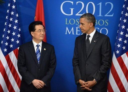 US President Barack Obama (R) with Chinese President Hu Jintao before a bilateral meeting in Los Cabos, Mexico, on June 19, on the sidelines of the G20 summit. After years of pressure to take a greater role in global affairs, China and India have stepped up by contributing to a new IMF emergency fund -- from which the United States is absent