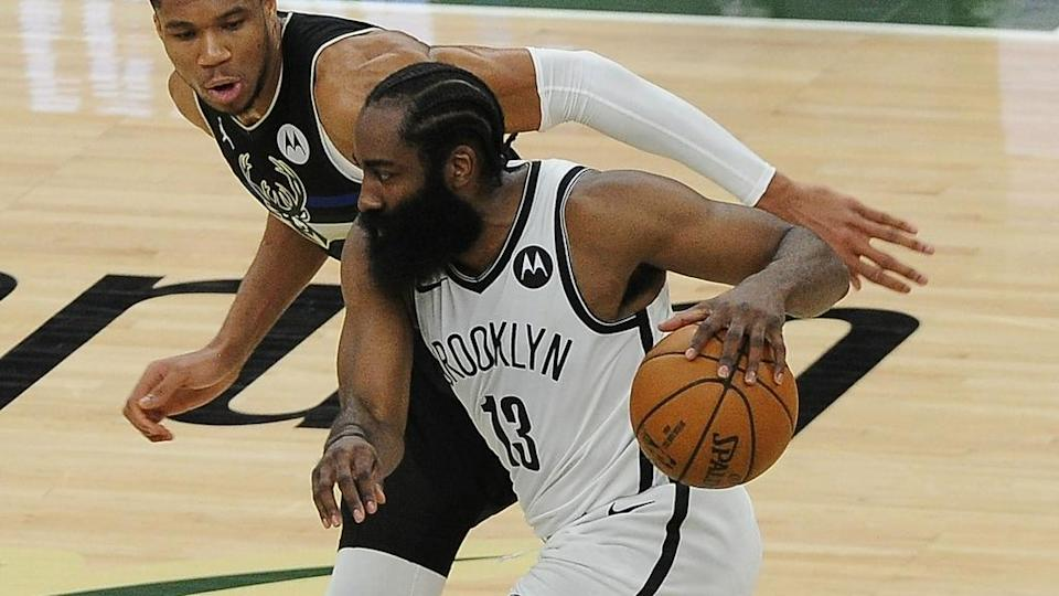 James Harden dribbles ball guarded by Giannis Game 6