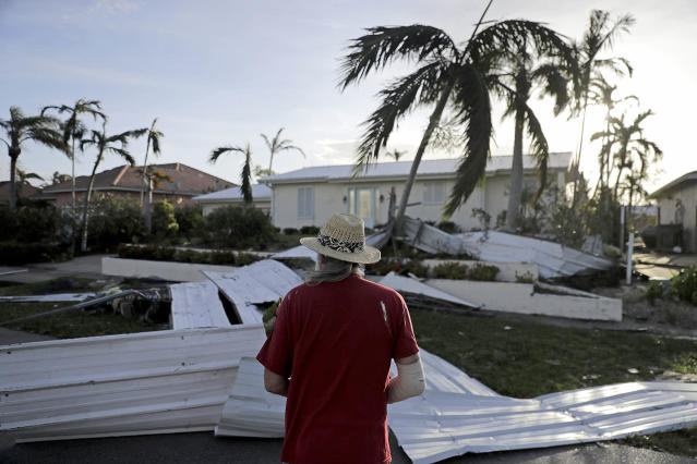 <p><strong>Marco Island</strong><br>A roof is strewn across a home's lawn as Rick Freedman checks his neighbor's damage from Hurricane Irma in Marco Island, Fla., Sept. 11, 2017. (Photo: David Goldman/AP) </p>