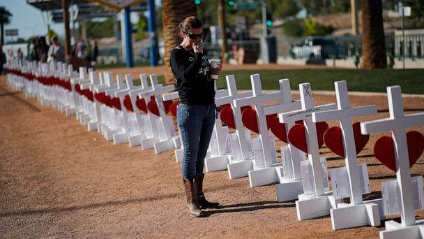 PHOTO: Jill Hale stands at a makeshift memorial for shooting victims, Tuesday, Oct. 1, 2019, in Las Vegas, on the anniversary of the mass shooting two years earlier. (John Locher/AP)