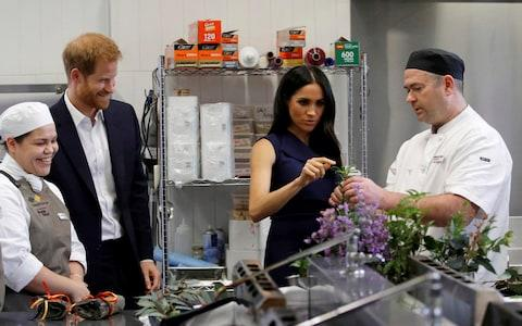 The Duke and Duchess get to touch, taste and smell native herbs and spices during a visit to the Mission Australia restaurant - Credit: Phil Noble/Reuters