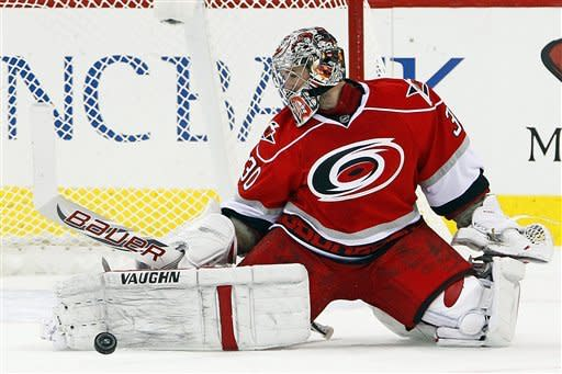 Carolina Hurricanes' Cam Ward (30) blocks a shot during the second period of an NHL hockey game against the Buffalo Sabres in Raleigh, N.C., Thursday, Jan. 24, 2013. The Hurricanes won 6-3. (AP Photo/Karl B DeBlaker)