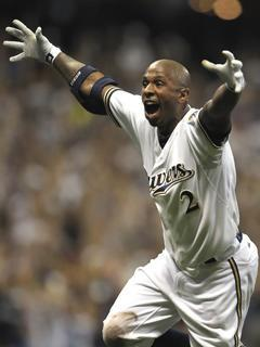 Nyjer Morgan celebrates his game-winning hit before being mobbed by teammates as the Brewers beat the Diamondbacks 3-2 to advance to the NLCS