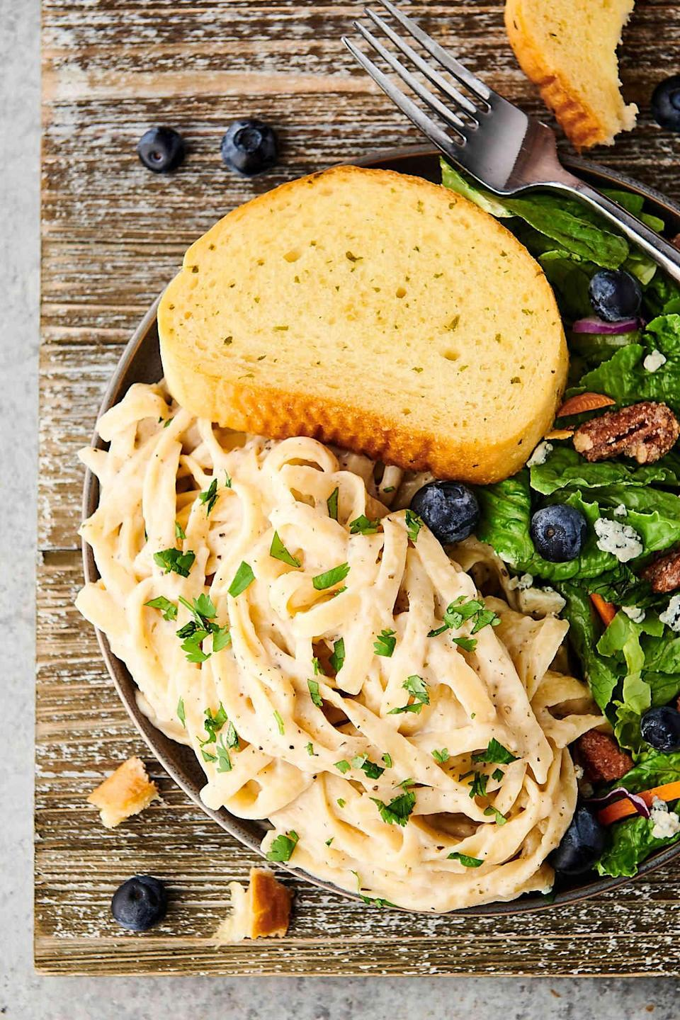"""<p>Who's hungry? This recipe will make your mouth water, so read with caution. Since the pasta cooks directly in the sauce, these noodles are rich and perfectly flavored. Mixed with skim milk, butter, garlic, Parmesan, and Italian seasonings, you'll be enjoying this meal in no time. To make the right amount of food for two people, you can easily adjust the recipe where it says """"yield.""""</p> <p><strong>Get the recipe:</strong> <a href=""""https://showmetheyummy.com/one-pot-fettuccine-alfredo-pasta/"""" class=""""link rapid-noclick-resp"""" rel=""""nofollow noopener"""" target=""""_blank"""" data-ylk=""""slk:one-pot fettuccine alfredo pasta"""">one-pot fettuccine alfredo pasta</a></p>"""