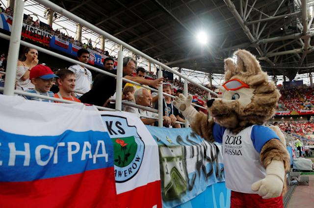 Soccer Football - World Cup - Group H - Poland vs Senegal - Spartak Stadium, Moscow, Russia - June 19, 2018 World Cup mascot Zabivaka with fans at half time REUTERS/Maxim Shemetov