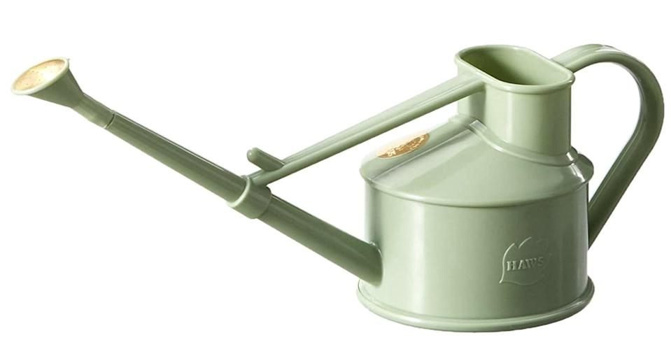 <p>We love the pretty sage-green color of this <span>Bosmere Haws Indoor Plastic Watering Can</span> ($15). Its miniature size is ideal for indoor gardening. </p>