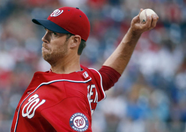 Washington Nationals starting pitcher Doug Fister throws during the first inning of a baseball game against the Atlanta Braves at Nationals Park on Saturday, June 21, 2014, in Washington. (AP Photo/Alex Brandon)