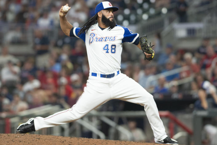 Atlanta Braves relief pitcher Richard Rodriguez throws in the during the eighth inning of a baseball game against the Milwaukee Brewers, Saturday, July 31, 2021, in Atlanta. (AP Photo/Hakim Wright Sr.)