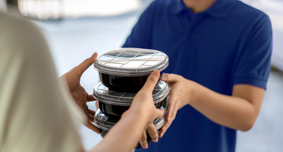 Stock image of food being handed over.