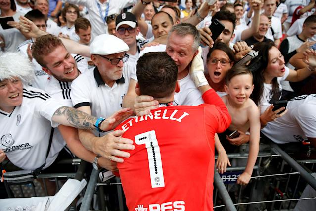"Soccer Football - Championship Play-Off Final - Fulham vs Aston Villa - Wembley Stadium, London, Britain - May 26, 2018 Fulham's Marcus Bettinelli celebrates promotion to the Premier League with the fans Action Images via Reuters/Carl Recine EDITORIAL USE ONLY. No use with unauthorized audio, video, data, fixture lists, club/league logos or ""live"" services. Online in-match use limited to 75 images, no video emulation. No use in betting, games or single club/league/player publications. Please contact your account representative for further details."
