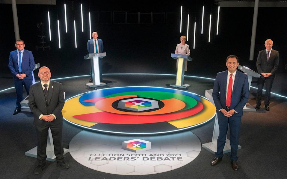 For use in UK, Ireland or Benelux countries only BBC handout photo of (clockwise from top left) presenter Glenn Campbell, Scottish National Party leader Nicola Sturgeon, Scottish Liberal Democrat leader Willie Rennie, Scottish Labour leader Anas Sarwar Scottish Greens co-leader Patrick Harvie and Scottish Conservative leader Douglas Ross, during the Election Scotland 2021: Leaders' Debate at Edinburgh's Corn Exchange. PA Photo. Picture date: Tuesday May 4, 2021. The Scottish Parliamentary elections take place on Thursday. See PA story SCOTLAND Election. Photo credit should read: Kirsty Anderson/BBC/PA Wire NOTE TO EDITORS: Not for use more than 21 days after issue. You may use this picture without charge only for the purpose of publicising or reporting on current BBC programming, personnel or other BBC output or activity within 21 days of issue. Any use after that time MUST be cleared through BBC Picture Publicity. Please credit the image to the BBC and any named photographer or independent programme maker, as described in the caption. - Kirsty Anderson/BBC/PA Wire