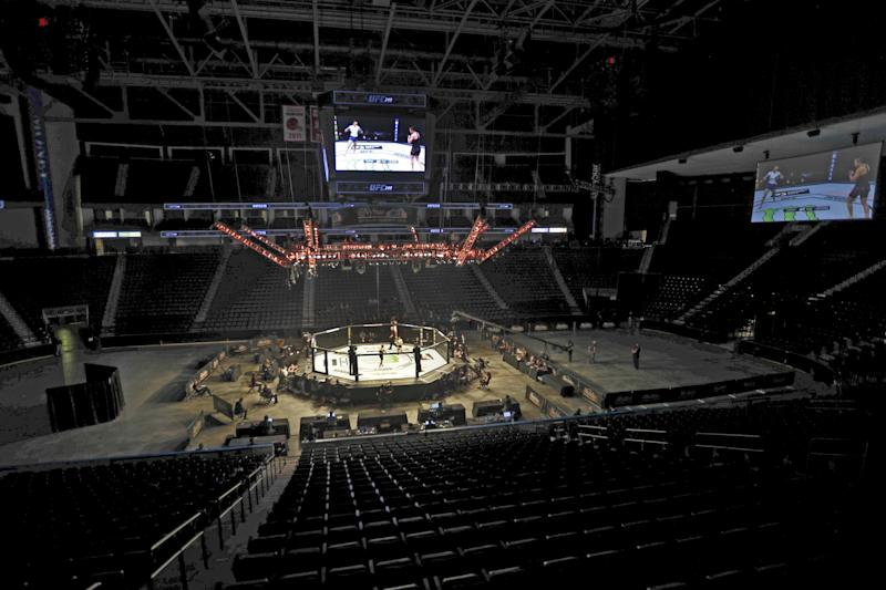 Fighters battle without spectators during a UFC 249 mixed martial arts bout, Saturday, May 9, 2020, in Jacksonville, Fla. (AP Photo/John Raoux)