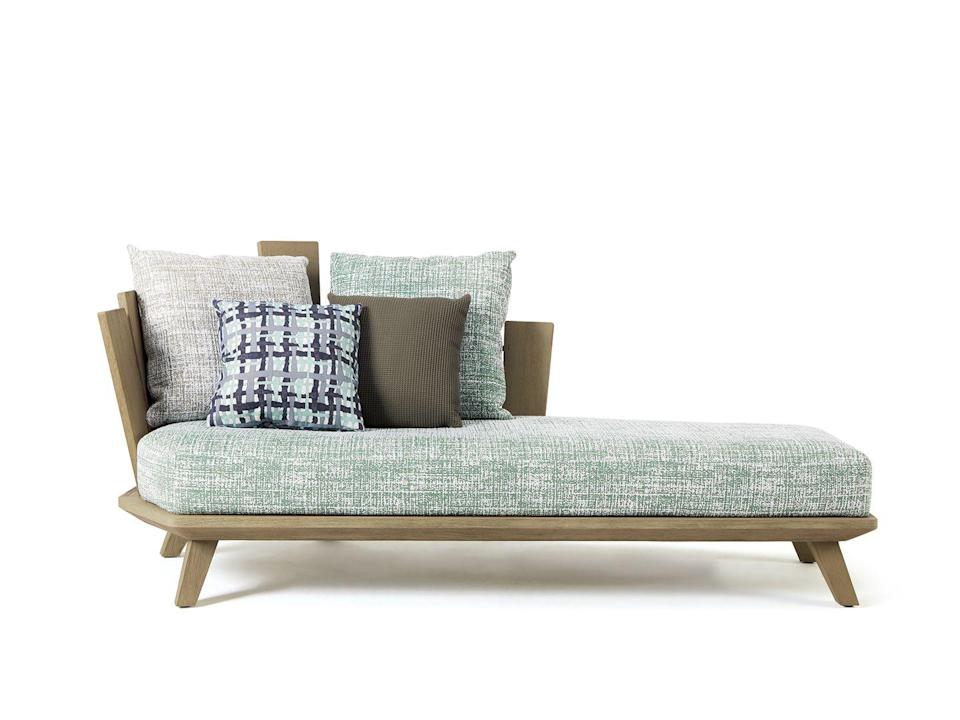 """<p>The unusual backrest of this design by Paola Navone has echoes of driftwood on the beach, with various sizes of brushed or pickled teak beams held together by visible metal staples. From £1,792, <a href=""""https://www.ethimo.com/en/product/rafael-daybed"""" rel=""""nofollow noopener"""" target=""""_blank"""" data-ylk=""""slk:Ethimo"""" class=""""link rapid-noclick-resp"""">Ethimo</a></p>"""