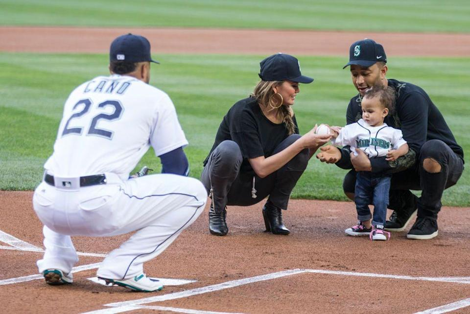 <p>Little Luna threw the first pitch (with a little help from Teigen) at a baseball game between the Minnesota Twins and Seattle Mariners in Seattle.</p>