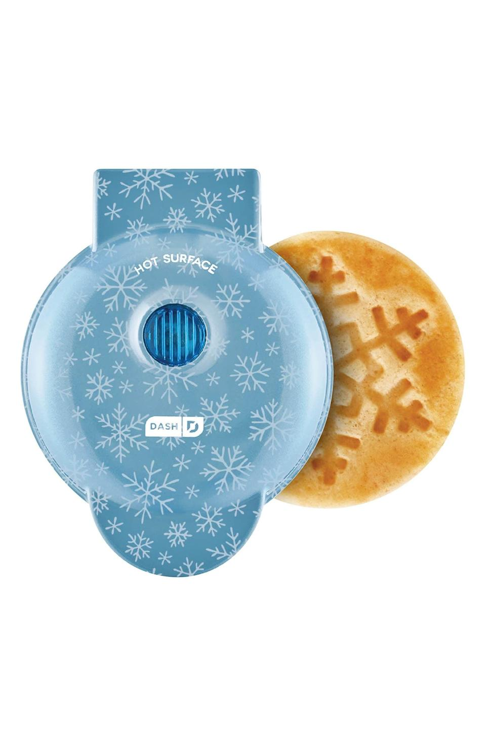 <p>We can't help but want this cute <span>Dash Mini Waffle Maker</span> ($20). It has us holiday ready.</p>