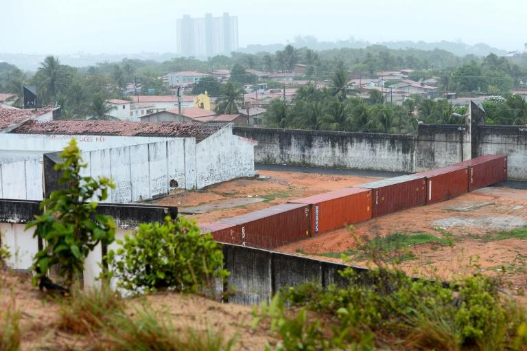 Police build a barrier with shipping containers to separate sections of a prison  near Natal in Rio Grande do Norte, Brazil, after gang violence erupted in January, 2017