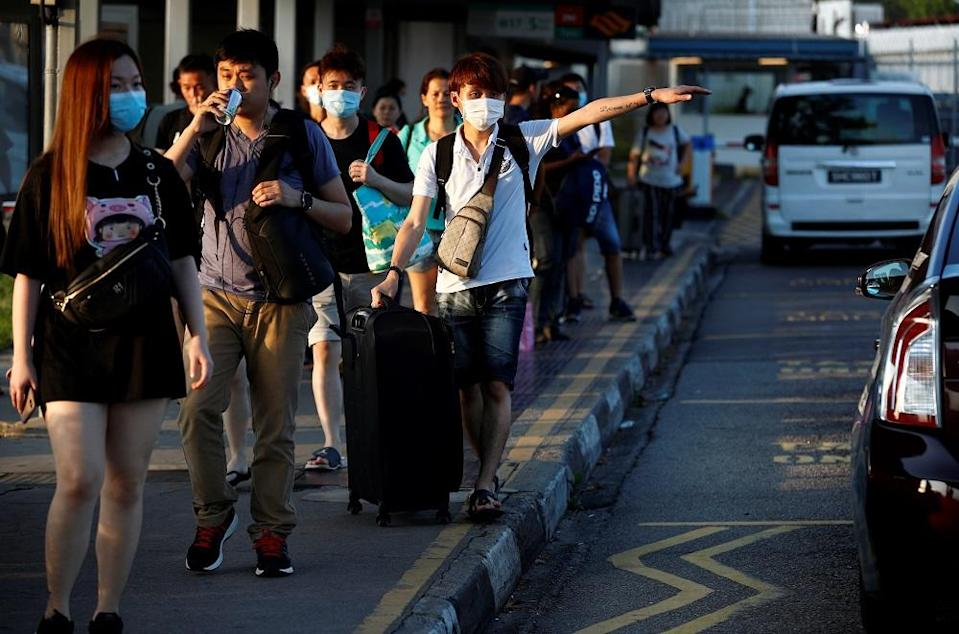 Despite thousands of Malaysians in Singapore waiting to return home, Ismail Sabri said only three person have crossed the border so far. — Reuters pic
