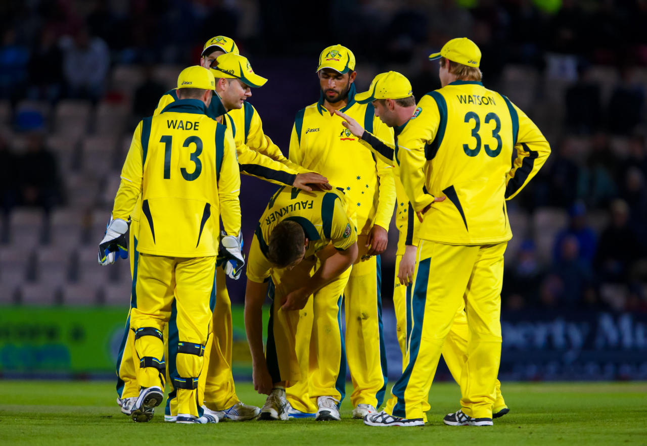 Australia congratulate James Faulkner on the wicket of England's Jos Buttler during the Fifth One Day International at the Ageas Bowl, Southampton.