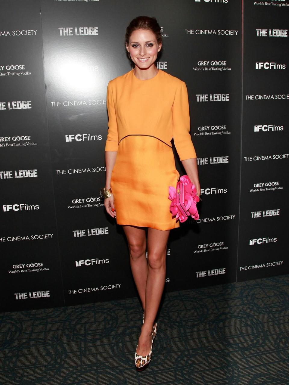 The tangerine Victoria Beckham dress, although elegant on its own, was brought up a knotch with a hot pink clutch.