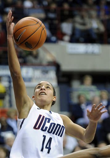 Connecticut's Bria Hartley scores in the second half of her team's 94-37 victory over Marquette in an NCAA college basketball game in Storrs, Conn., Tuesday, Feb. 5, 2013. Hartley scored 20 points in the victory. (AP Photo/Fred Beckham)
