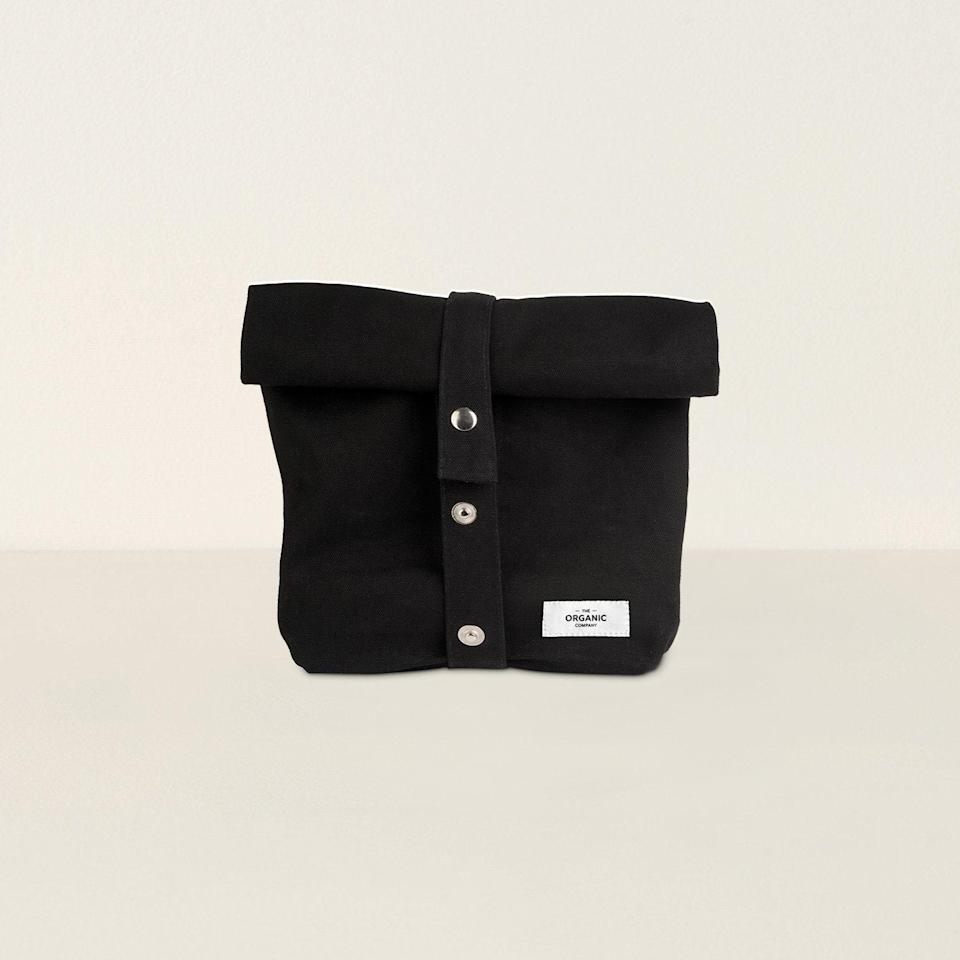 """Say farewell to brown paper bags and hello to this organic cotton cloth sack with a stylish snap closure. $21, GOODEE. <a href=""""https://www.goodeeworld.com/collections/all/products/lunch-bag-black"""" rel=""""nofollow noopener"""" target=""""_blank"""" data-ylk=""""slk:Get it now!"""" class=""""link rapid-noclick-resp"""">Get it now!</a>"""