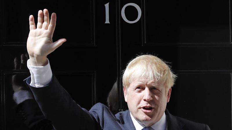 FILE - In this file photo dated Wednesday, July 24, 2019, Britain's Prime Minister Boris Johnson waves from the steps outside 10 Downing Street in London. In a letter released Wednesday Aug. 28, 2019, Prime Minister Johnson has written to fellow lawmakers explaining his decision to ask Queen Elizabeth II to suspend Parliament as part of the government plans before the Brexit split from Europe.