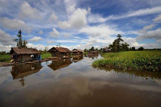 Floating houses sit on the placid waters of the Agusan marshland in the southern Philippnies. A few hundred people live on wooden house boats at Lake Mihaba, part of the 15,000-hectare Agusan marshland that is one of the Philippines' most ecologically significant wetlands