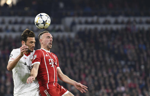 Bayern's Franck Ribery, right, and Sevilla's Franco Damian Vazquez go for a header during the Champions League quarter final second leg soccer match between FC Bayern Munich and Sevilla FC at the Allianz Arena stadium in Munich, Germany, Wednesday, April 11, 2018. (Sven Hoppe/dpa via AP)