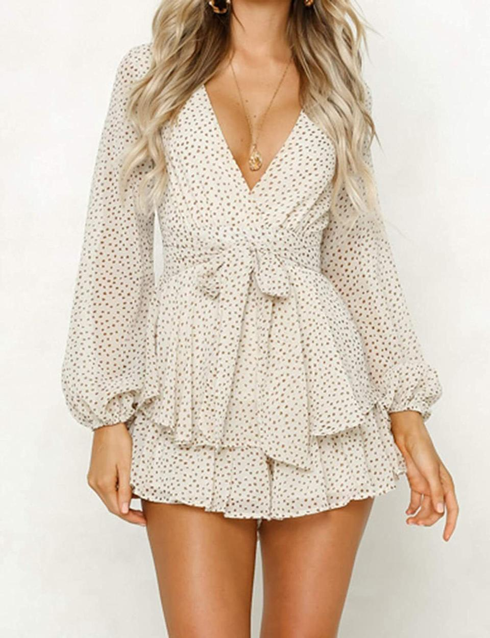 """You won't have to worry about windy conditions in this since the shorts will have you covered, and the romantic ruffles? Oh, they'll make this piece your perfect match for all warm-weather activities.<br /><br /><strong>Promising review:</strong>""""This is probably my favorite romper to date! You can dress it up with heels, wedges or make it a more casual outfit with a cute jean jacket and white sneakers."""" —<a href=""""https://www.amazon.com/gp/customer-reviews/R1DSA9HRPL4AX0?&linkCode=ll2&tag=huffpost-bfsyndication-20&linkId=33e96c97e9bbed0c87b0ad3d16154b52&language=en_US&ref_=as_li_ss_tl"""" target=""""_blank"""" rel=""""nofollow noopener noreferrer"""" data-skimlinks-tracking=""""5925990"""" data-vars-affiliate=""""Amazon"""" data-vars-href=""""https://www.amazon.com/gp/customer-reviews/R1DSA9HRPL4AX0?tag=bfjasminsandal-20&ascsubtag=5925990%2C21%2C36%2Cmobile_web%2C0%2C0%2C16629499"""" data-vars-keywords=""""cleaning,fast fashion"""" data-vars-link-id=""""16629499"""" data-vars-price="""""""" data-vars-product-id=""""21061352"""" data-vars-product-img="""""""" data-vars-product-title="""""""" data-vars-retailers=""""Amazon"""">Farzad Ezami</a><br /><br /><a href=""""https://www.amazon.com/Relipop-Womens-Jumpsuits-V-Neck-Rompers/dp/B07M6VRDDK?&linkCode=ll1&tag=huffpost-bfsyndication-20&linkId=c1146023d5277d87dc113fed64b4c375&language=en_US&ref_=as_li_ss_tl"""" target=""""_blank"""" rel=""""noopener noreferrer""""><strong>Get it from Amazon for$23.99+(available in sizes S-XL and in nine colors and patterns).</strong></a>"""