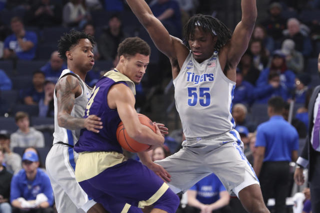 Memphis' Precious Achiuwa (55) and Tyler Harris (1) move in to defend Alcorn State Arne Morris (24) in the second half of an NCAA college basketball game Saturday, Nov. 16, 2019, in Memphis, Tenn. (AP Photo/Karen Pulfer Focht)