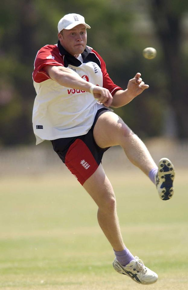 29 Sep 2001:  Andrew Flintoff of England in action fielding during the England nets session on the England One Day International tour to ZImbabwe, at the Alexander Sports Ground, Harare, Zimbabwe. DIGITAL IMAGE. Mandatory Credit: Tom Shaw/ALLSPORT