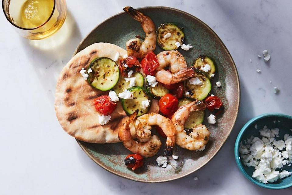 "This summery, Greek-inspired dinner comes together in a snap with the help of a grill basket. <a href=""https://www.epicurious.com/recipes/food/views/grilled-shrimp-zucchini-and-tomatoes-with-feta?mbid=synd_yahoo_rss"" rel=""nofollow noopener"" target=""_blank"" data-ylk=""slk:See recipe."" class=""link rapid-noclick-resp"">See recipe.</a>"