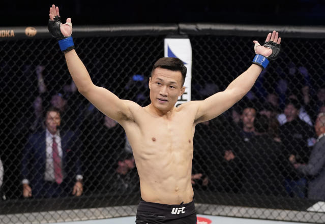 Chan Sung Jung of South Korea celebrates after knocking Frankie Edgar out in their featherweight fight during the UFC Fight Night event at Sajik Arena 3 on Dec. 21, 2019 in Busan, South Korea. (Jeff Bottari/Zuffa LLC via Getty Images)