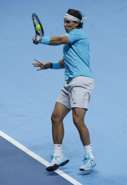Rafael Nadal of Spain plays a return to Roger Federer of Switzerland during their ATP World Tour Finals single semifinal tennis match at the O2 Arena in London Sunday, Nov. 10, 2013. (AP Photo/Sang Tan)