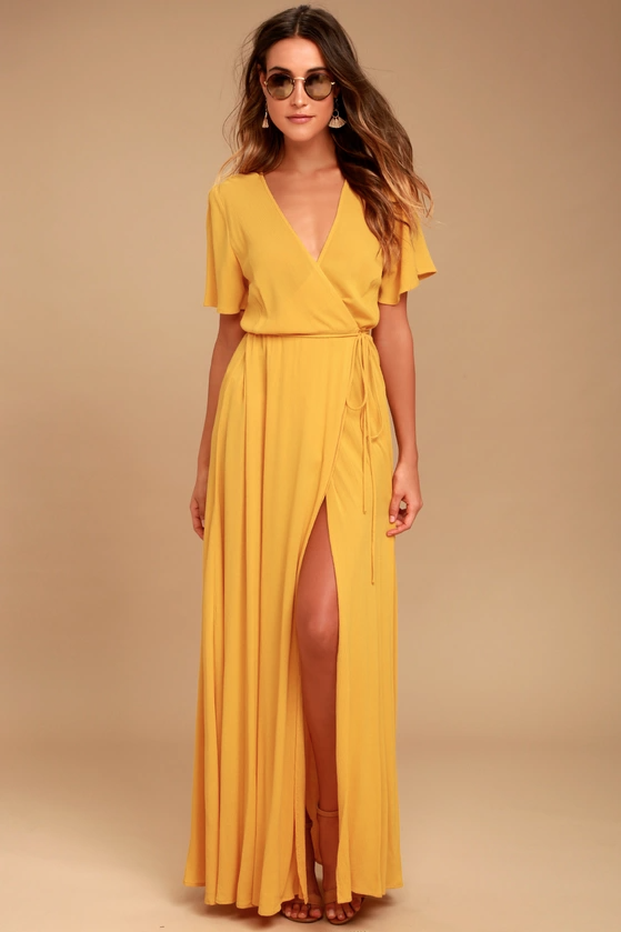 """<h2>Much Obliged Golden Yellow Wrap Maxi Dress</h2><br>Over 1,000 reviewers awarded this lengthy frock four out of five stars, citing its versatility and easy fit. """"I love the color of this dress and it was perfect for what I needed. Not overly fancy, but also not casual. A medium fit me great. The only thing was that I was afraid of it being see-through even though it has a liner. But that didn't stop me from loving it!""""<br><br><strong>Lulus</strong> Much Obliged Golden Yellow Wrap Maxi Dress, $, available at <a href=""""https://go.skimresources.com/?id=30283X879131&url=https%3A%2F%2Fwww.lulus.com%2Fproducts%2Fmuch-obliged-golden-yellow-wrap-maxi-dress%2F460442.html"""" rel=""""nofollow noopener"""" target=""""_blank"""" data-ylk=""""slk:Lulus"""" class=""""link rapid-noclick-resp"""">Lulus</a>"""
