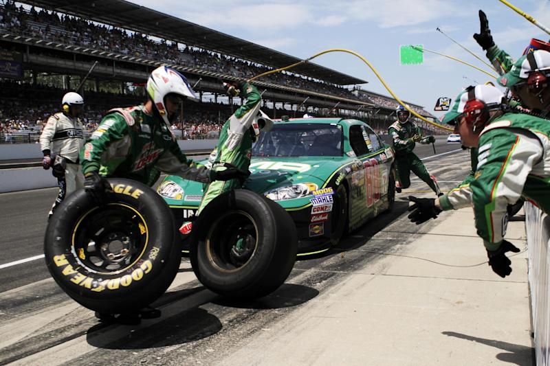 Dale Earnhardt Jr., makes a pit stop during the NASCAR Sprint Cup Series Brickyard 400 auto race at Indianapolis Motor Speedway in Indianapolis, Sunday, July 29, 2012. (AP Photo/Robert Baker)