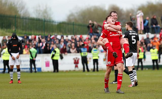"Soccer Football - League Two - Accrington Stanley v Lincoln City - Wham Stadium, Accrington, Britain - April 28, 2018 Accrington Stanley's Jimmy Dunne and Mark Hughes celebrate at the end of the match Action Images/Andrew Boyers EDITORIAL USE ONLY. No use with unauthorized audio, video, data, fixture lists, club/league logos or ""live"" services. Online in-match use limited to 75 images, no video emulation. No use in betting, games or single club/league/player publications. Please contact your account representative for further details."
