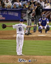 Los Angeles Dodgers starting pitcher Kenta Maeda, left, of Japan, gets set to pitch to Arizona Diamondbacks' Jarrod Dyson during the sixth inning of a baseball game Saturday, March 30, 2019, in Los Angeles. (AP Photo/Mark J. Terrill)