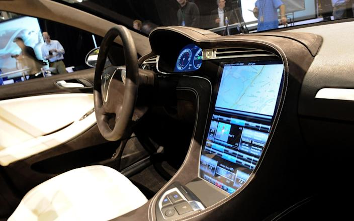 The touch-screen control panel of the new Tesla Model S all-electric sedan - AFP