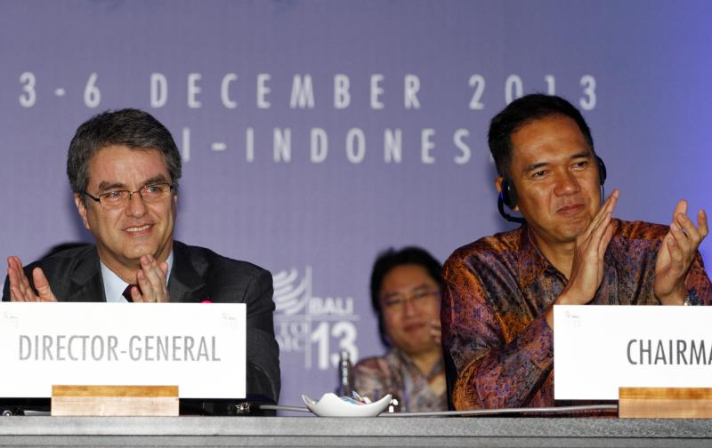 Indonesian Trade Minister Gita Wiryawan, right, and World Trade Organization (WTO) Director-General Roberto Azevedo clap during the closing ceremony of the ninth WTO Ministerial Conference in Bali, Indonesia, Saturday, Dec. 7, 2013. (AP Photo/Firdia Lisnawati)