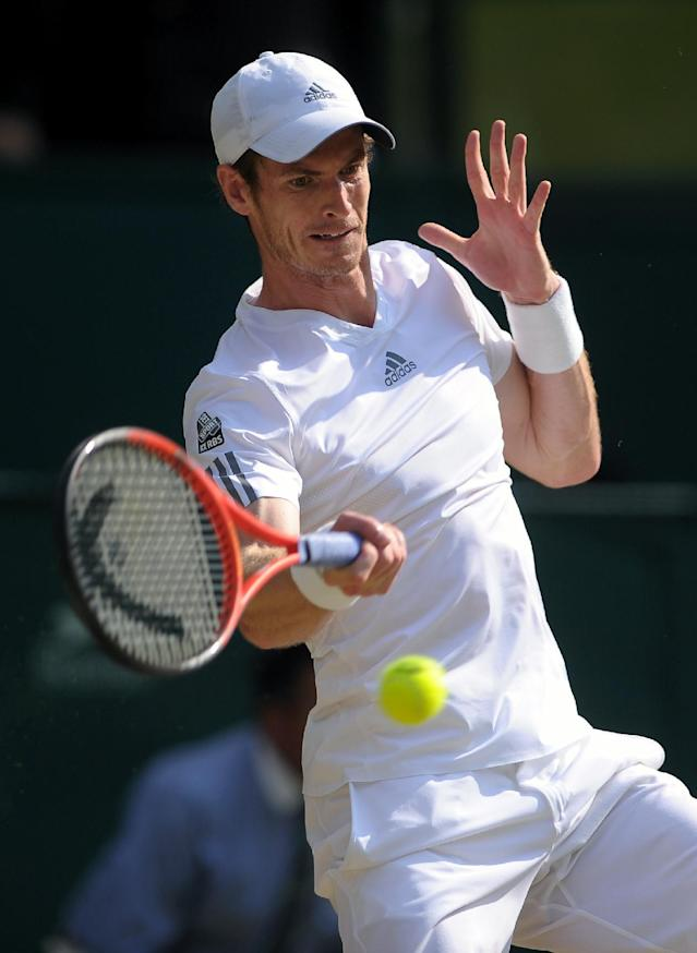 Great Britain's Andy Murray in action against Serbia's Novak Djokovic on day thirteen of the Wimbledon Championships at The All England Lawn Tennis and Croquet Club, Wimbledon.